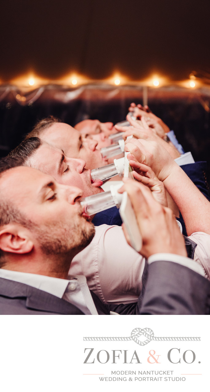 wedding shot ski groomsmen