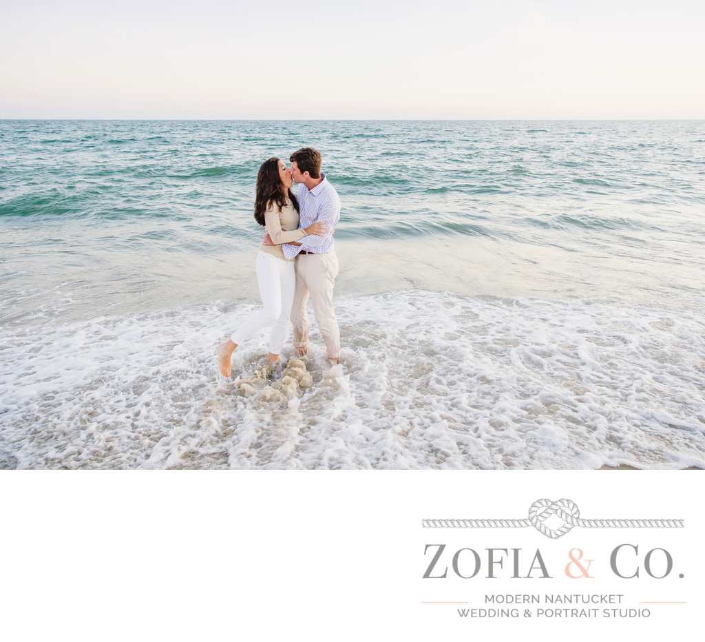 engagement couple getting soaked at the beach