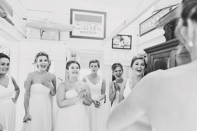 nantucket bridesmaids see bride in gown