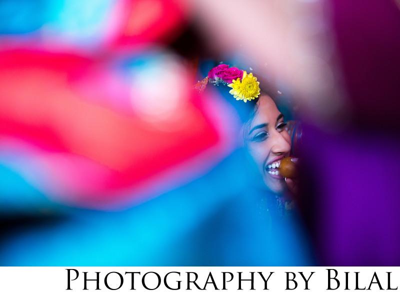 Mehndi day bride eating mithai