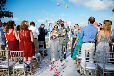 Brid and Groom leaving ceremony with beach balls