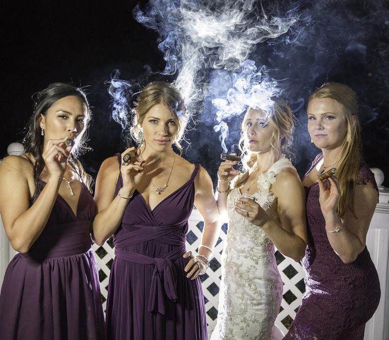 Bridesmaids smoking a cigar