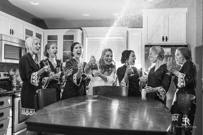 Wente Wedding Champagne popping bridal party photograph