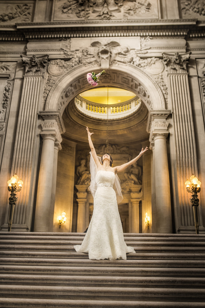 bride with bouquet top of grand staircase