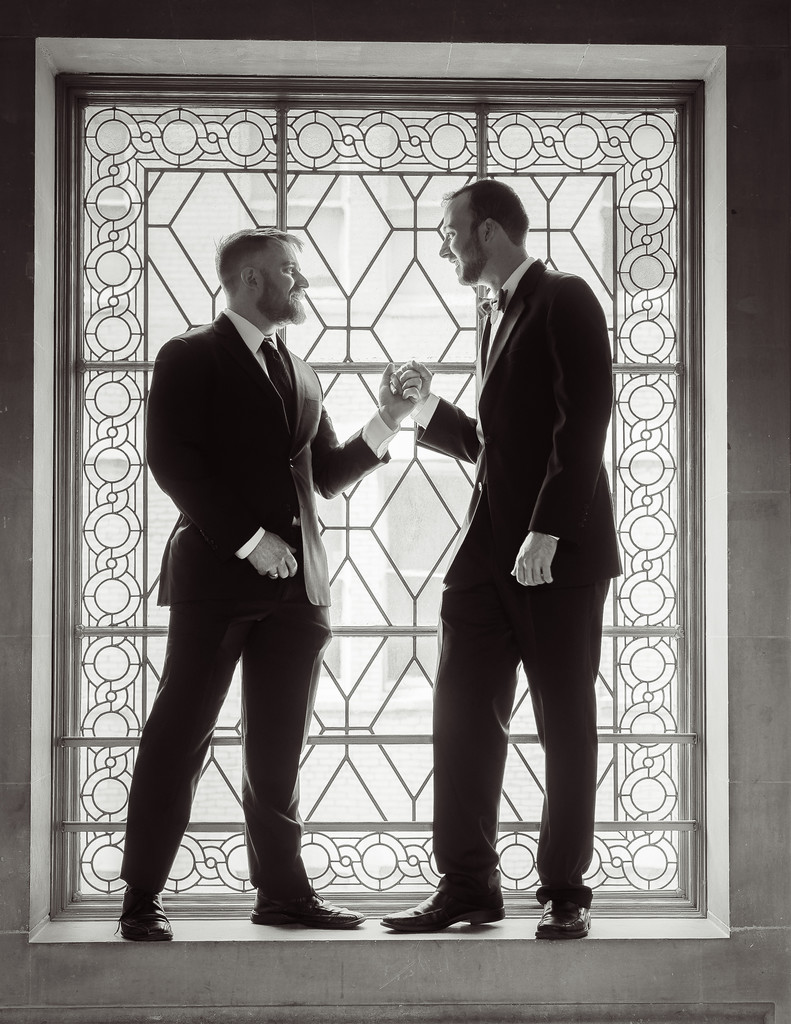 gay couple in window light