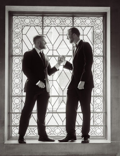 gay couple in window light