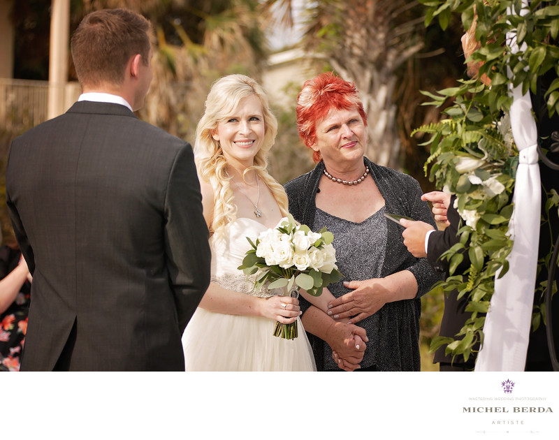 Groom bride and mom at wedding ceremony at Sea Side Point Wild Dunes Resort