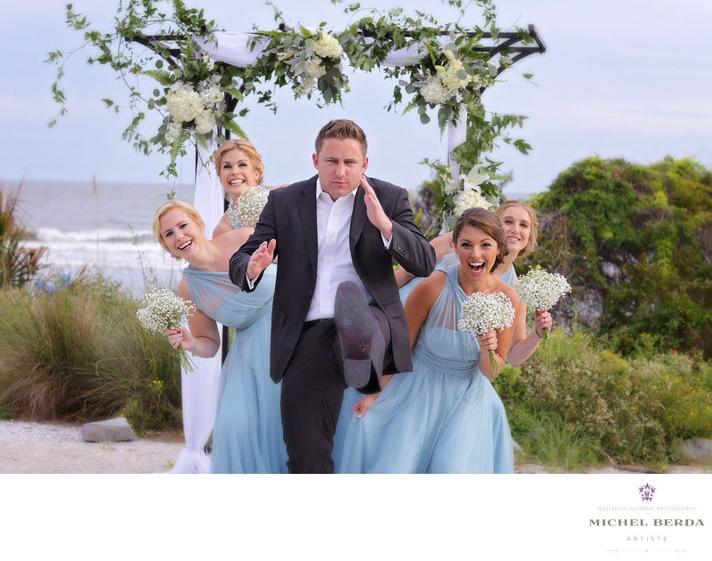 Groom with bridesmaids wedding ceremony at Sea Side Point Wild Dunes Resort