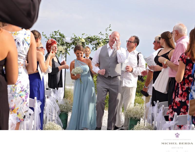 Groosmen emotion at wedding ceremony Sea Side Point Wild Dunes Resort