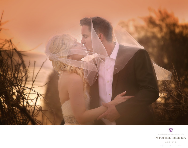 Bride And Groom Sunset kiss on the beach wedding ceremony Wild Dunes Resort