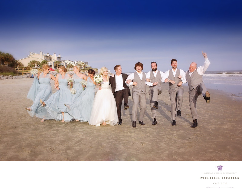 Bride and groom and bridal party at wedding ceremony at Sea Side Point Wild Dunes Resort