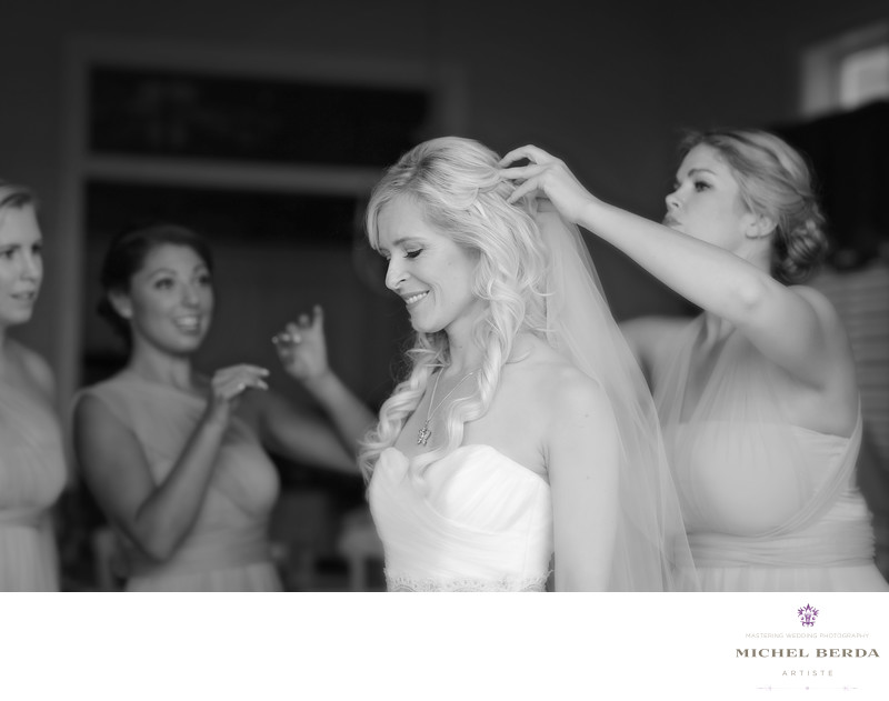 bridesmaids helping bride get ready Wild Dunes Resort Wedding