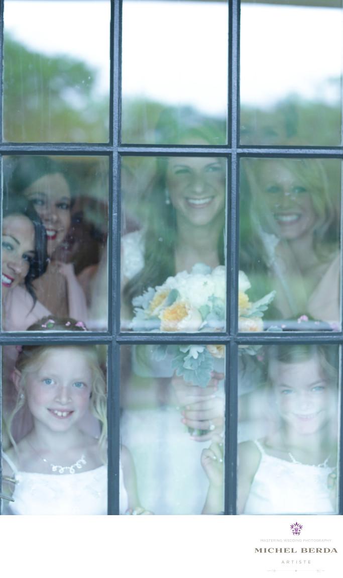 Looking through the glass door bride and bridemaids Dunes West Golf & River Club