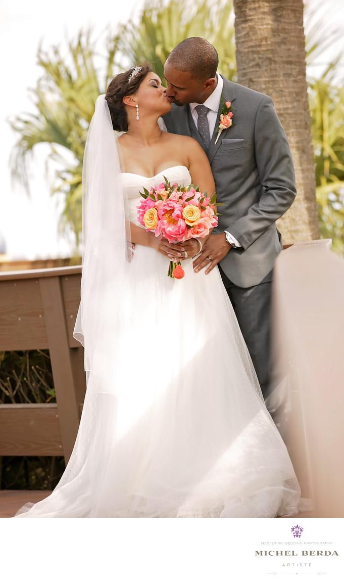 Bride and groom kiss deck THE WESTIN HILTON HEAD ISLAND RESORT & SPA