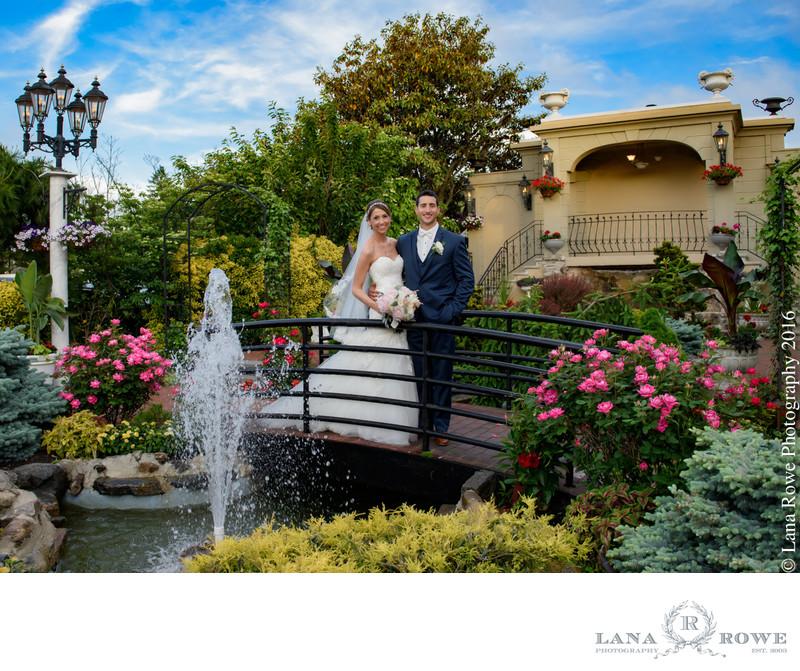 Bride and Groom on bridge in Jericho Terrace