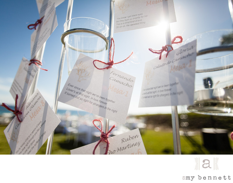 place cards hung by red ribbon