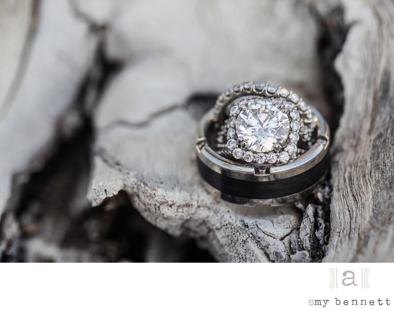 diamond wedding ring on wood
