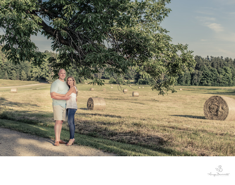 Engaged Couple With Hay Bales