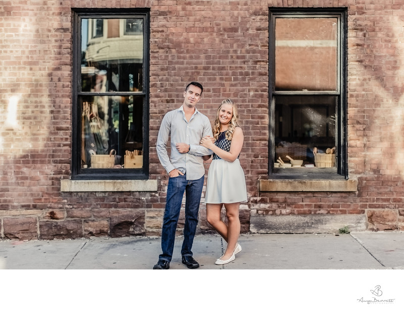 Engaged Couple Brick Wall Pose