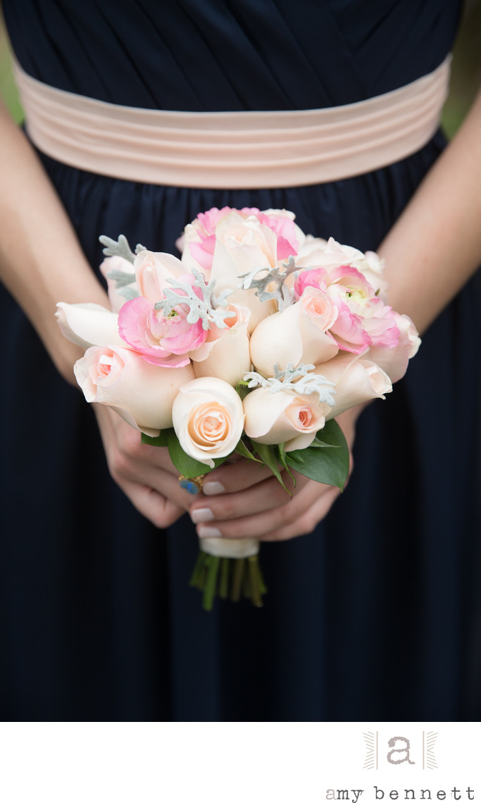 bridesmaid holding pink roses