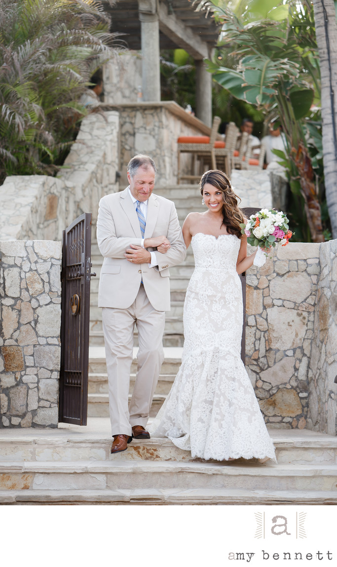 Excited Bride Walking Down Aisle With Father