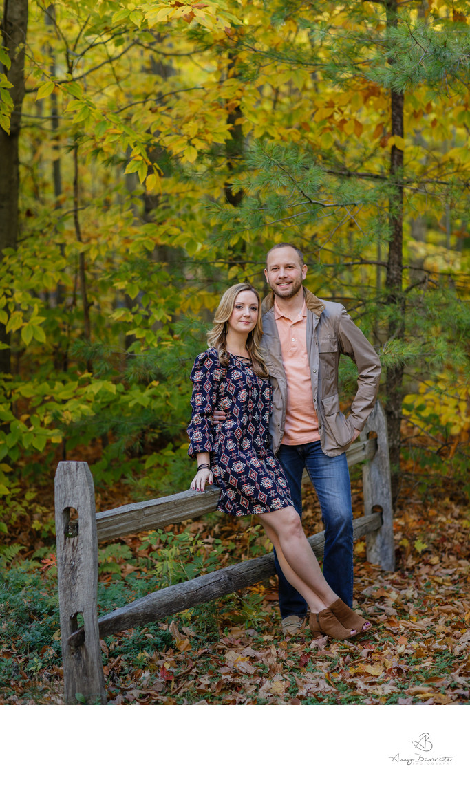 Couple Posing Against Fence in Vermont Woods
