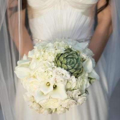 bride in wedding dress with bouquet