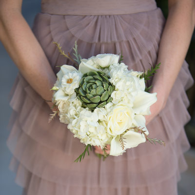 wedding bouquets held by bridesmaid