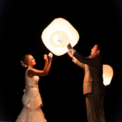 newlyweds holding lanterns