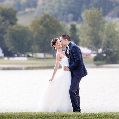 Groom Kisses Bride at Sensational Quechee Club