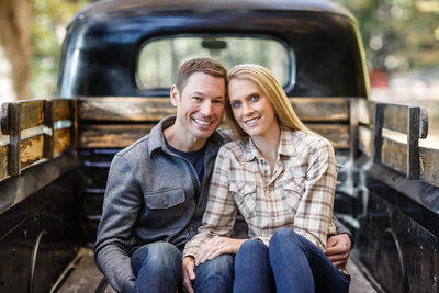 Smiling Couple in Pickup Truck