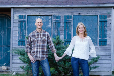 Happy Engaged Couple With Rustic Vermont Barn