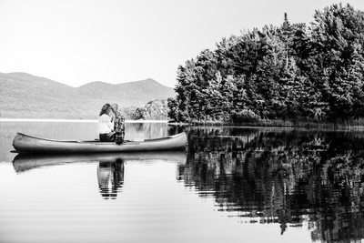 Engaged Couple in Canoe with Stunning Scenery