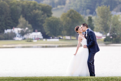 Groom Kisses Bride at Sensational Quechee Club