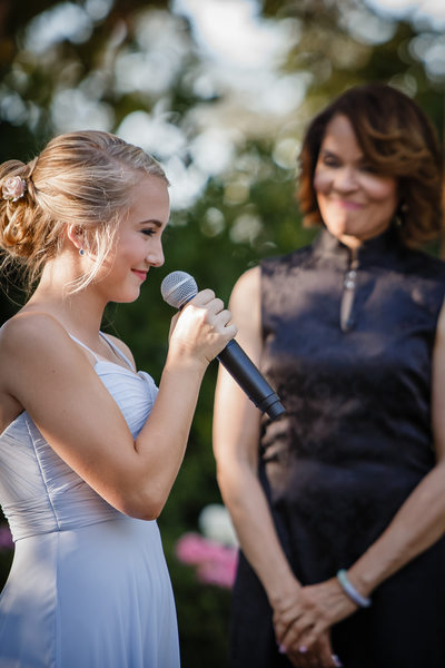 Happy Bridesmaid With Microphone