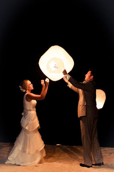 newlyweds holding lanterns