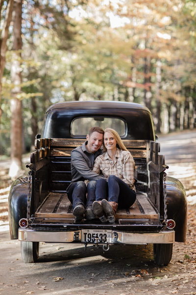 Engaged Couple Cuddling in Pickup Truck