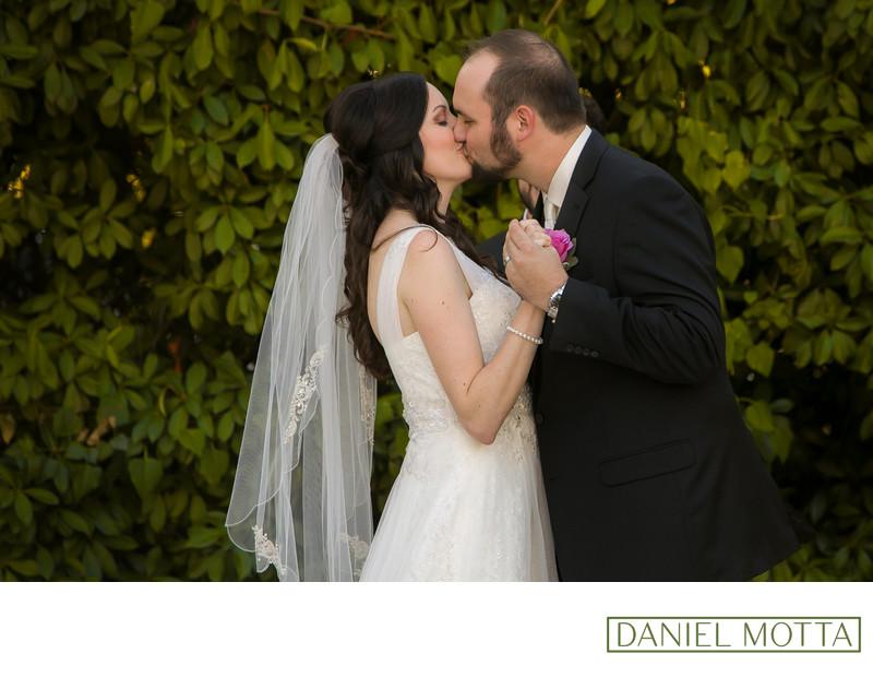 McKinney Couple Share Kiss Outdoors at Bingham House