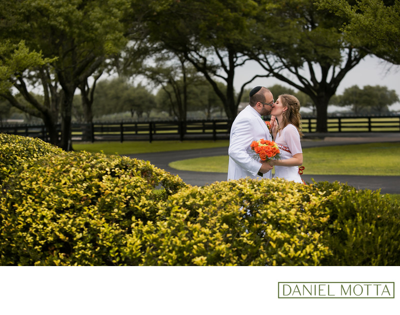 Wedding Photo of Couple Kissing at South Fork Ranch