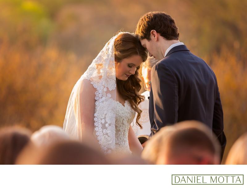 Photo of Bride Groom Praying During Wedding Ceremony
