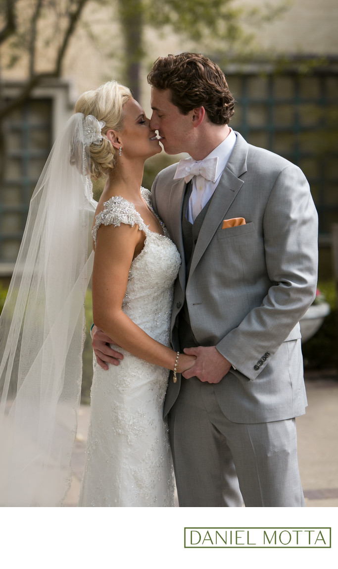 Dallas Bride and Groom Kiss During 1st Look at Wedding