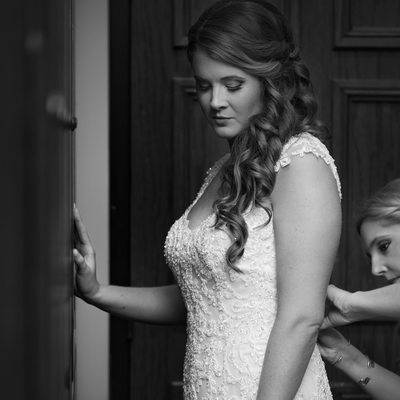 Bridesmaid Putting Final Touches on Glen Eagles Bride