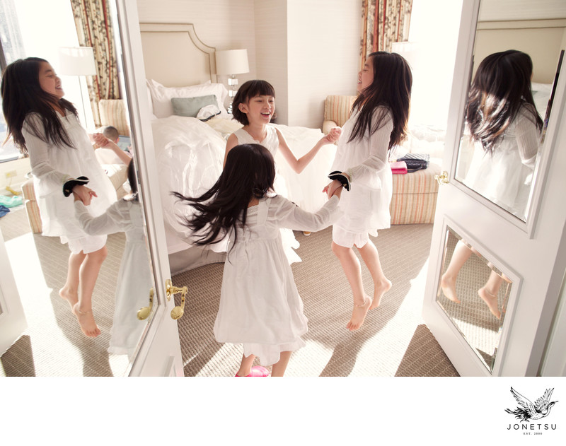 Flower girls play while bridal party gets ready