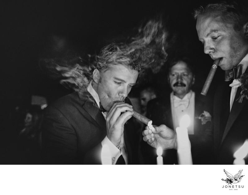 Groom and groomsmen enjoy post wedding cigars