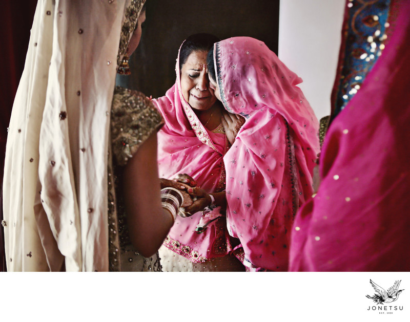 Mothers of Indian bride and groom share special moment