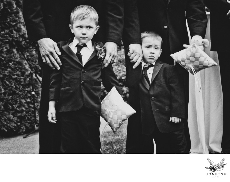 Ring bearers with ring pillows during ceremony