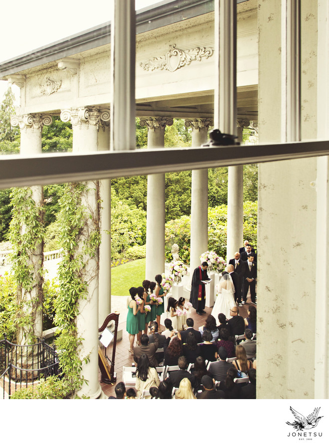 Hycroft wedding ceremony on portico from window