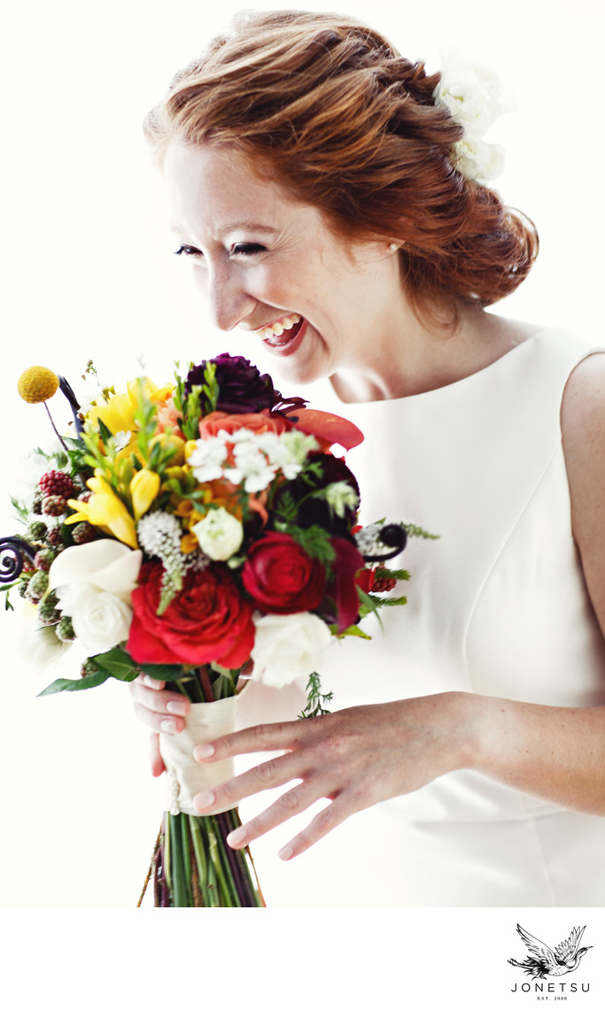 Bridal portrait with bright bouquet at Jewish wedding