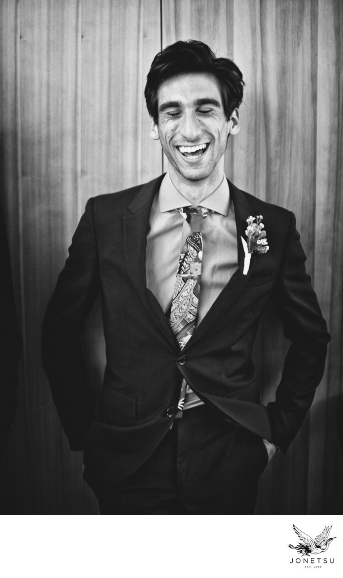 Laughing brother of the bride in black and white