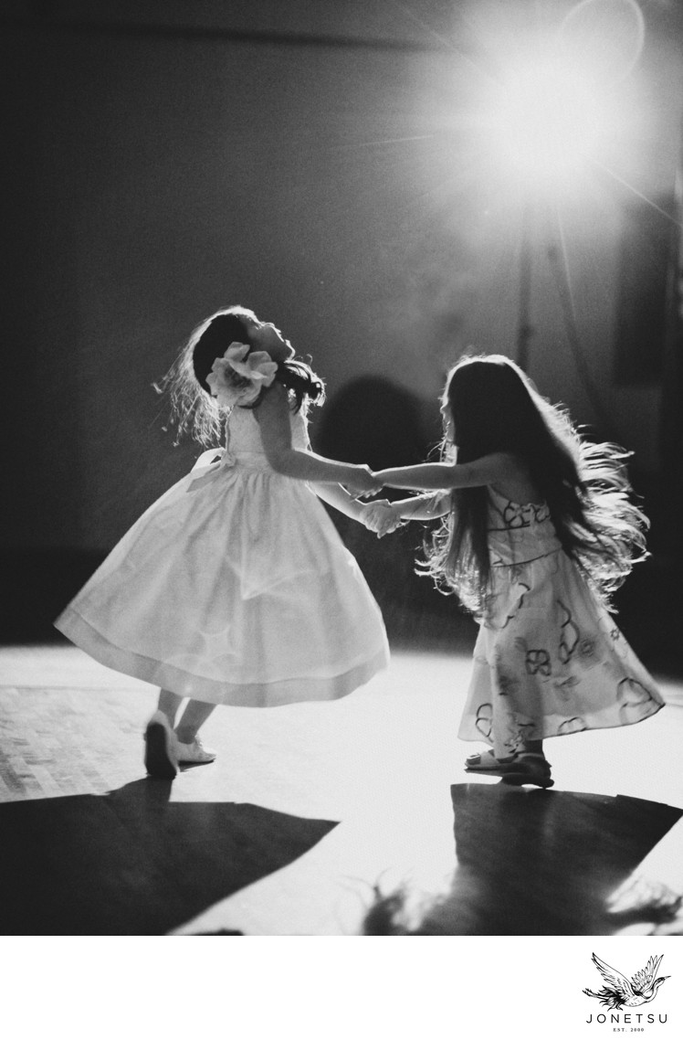 Flower girls wedding reception dancing black and white
